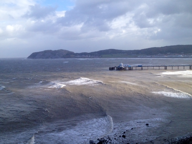 LLandudno Pier, North Wales in sea swell and spray raised by ex hurricane Gonzalo