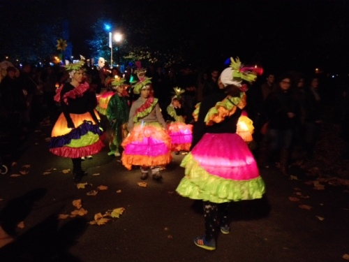 Dancers aglow, inspiring crowds to dance with them