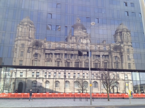 Beautifully refelcted in black, the white stone Port Of Liverpool Building. The classical design was originally considered as an option for Liverpool's Anglican Cathedral.